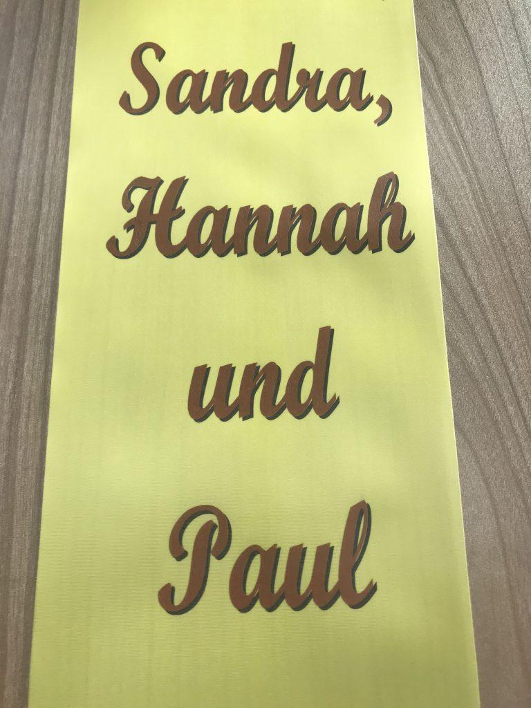 Schleife mit Laserdrucker in Braun mit Schatten Hintergrund gedruckt